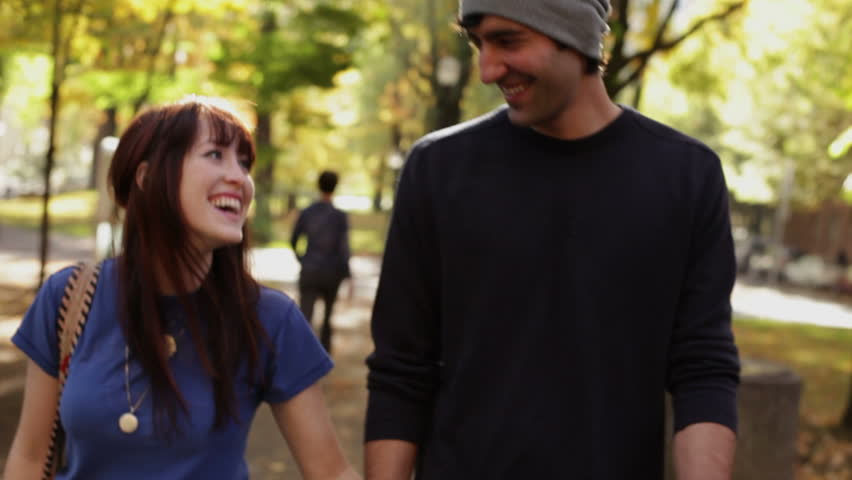 Romantic couple running and walking in park