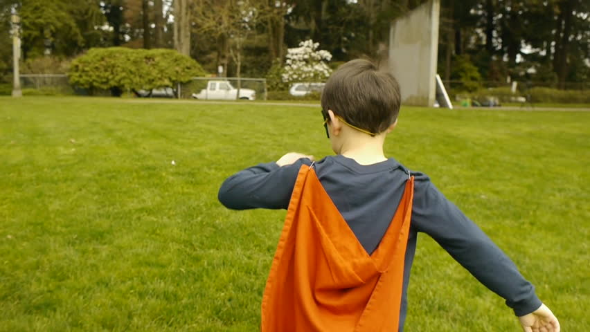 Superhero Boy Runs In Park