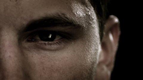 Extreme close up of man staring.