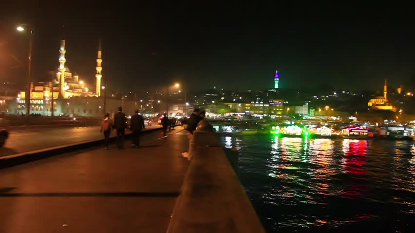 Night on the bridge. Eminonu region looking to Yeni Mosque and Beyazit Tower in