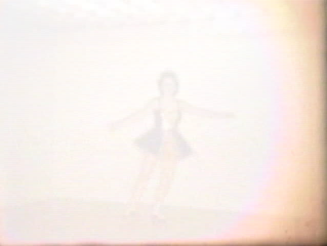 A slow motion home movie clip of a girl tap dancing. Shot in 1958 on old 8mm film)