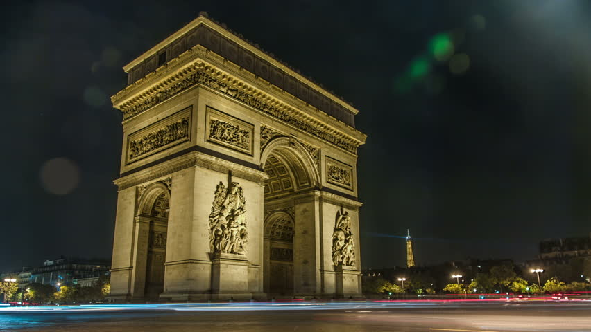 Time lapse : Traffic circulating around the Arc de Triomphe with the Eiffel Tower at the back at Paris, France | Shutterstock HD Video #5004518