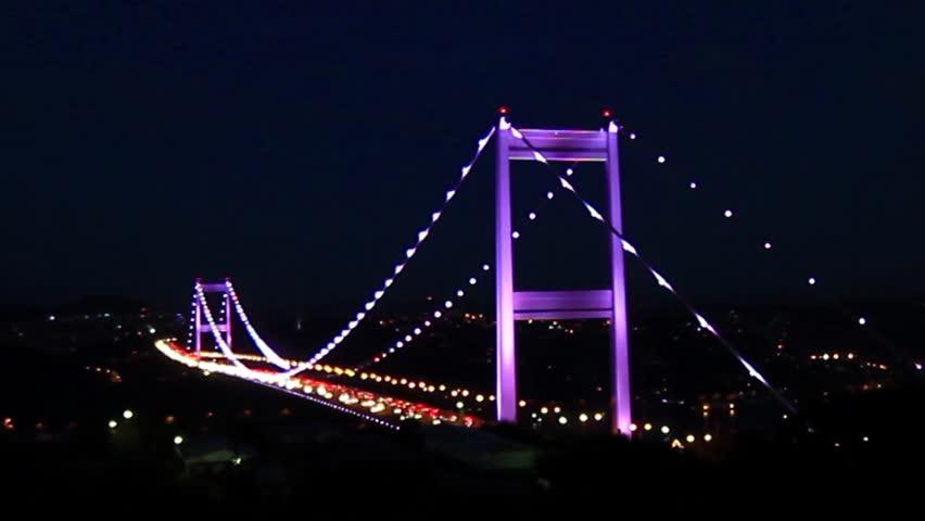 bridge at night. Zoom in to suspended bridge.