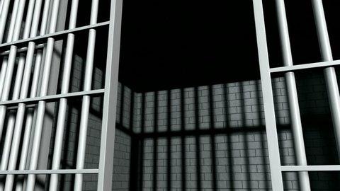 A static camera closeup of the door slamming shut a  brick jail cell with iron bars