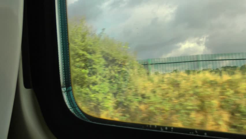 View from a train window passing through countryside
