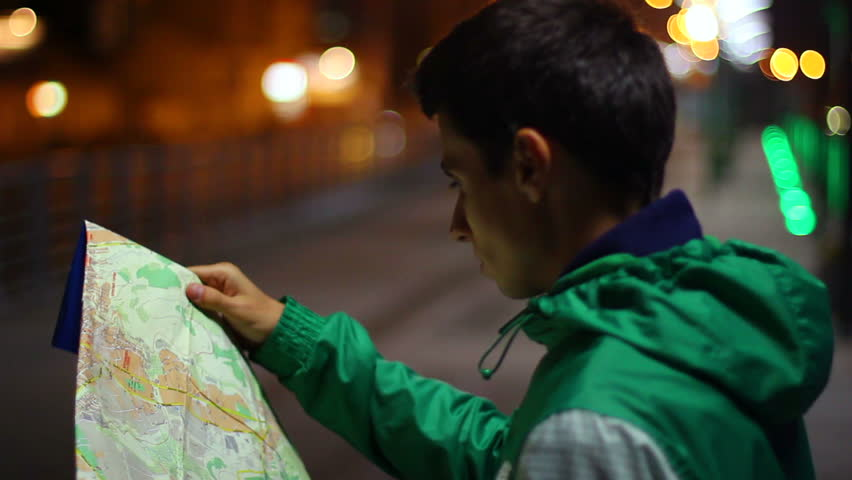 Lost tourist not citizen looking searching location map night