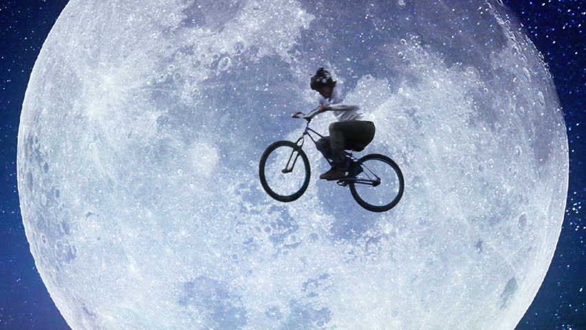 Moon bicycle slow motion, male bike flies across night sky