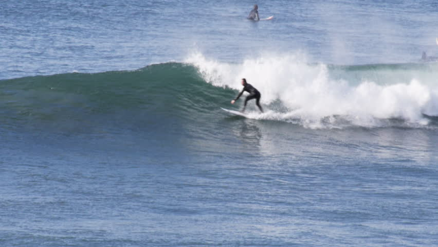 slow motion shot of a surfer doing a forehand cut-back on a wave at bells beach- recorded at 1080p 60fps