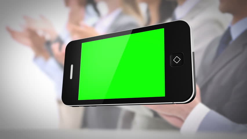 Smartphone with green screen in front of business people working in the office | Shutterstock HD Video #5068061