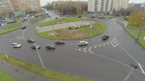 Cars ride by roundabout on Square of Bela Kun at autumn day in Moscow