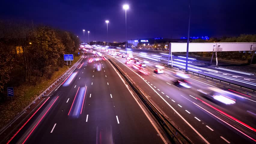 GLASGOW, SCOTLAND - November 15, 2013: Timelapse of traffic on busy highway, facing East.