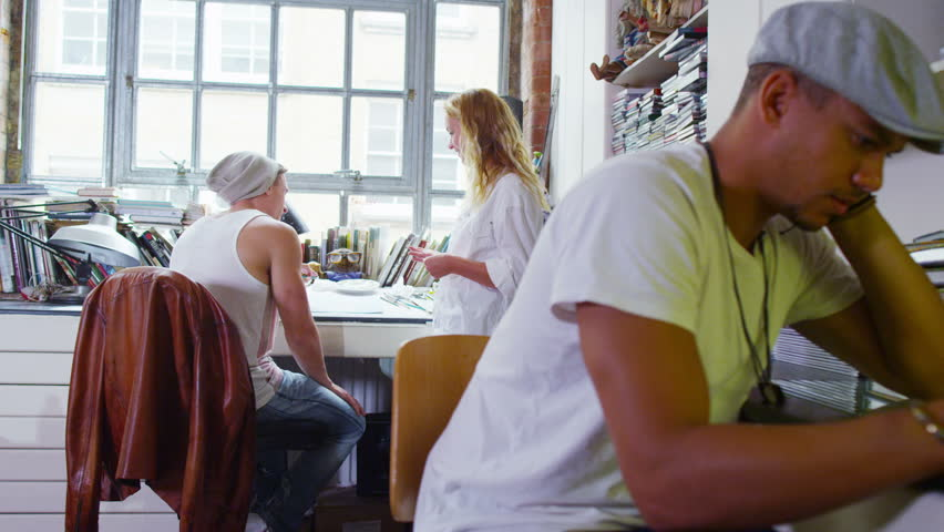Two young designers or artists collaborating together in their studio.  | Shutterstock HD Video #5096411