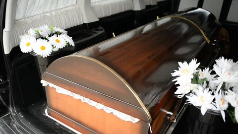 The coffin in a hearse
