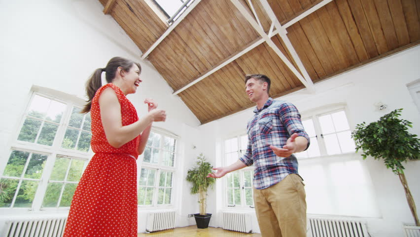 Happy young couple viewing a potential new home.    Shutterstock HD Video #5099228