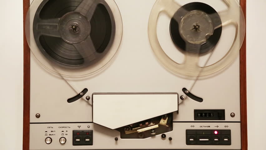 old reel tape recorder with spinning reels
