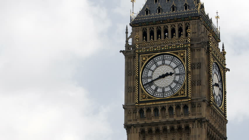 Time lapse footage zooming in and out of the clock face of the iconic London landmark, Big Ben, part of the Houses of Parliament.