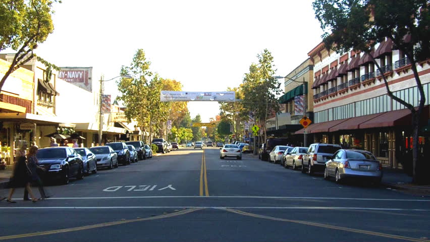 ORANGE, CA: November 16, 2013- Time lapse shot of the historic old downtown business district circa 2013 in Orange. Shows the high volume of foot and vehicle traffic centered around the town square.