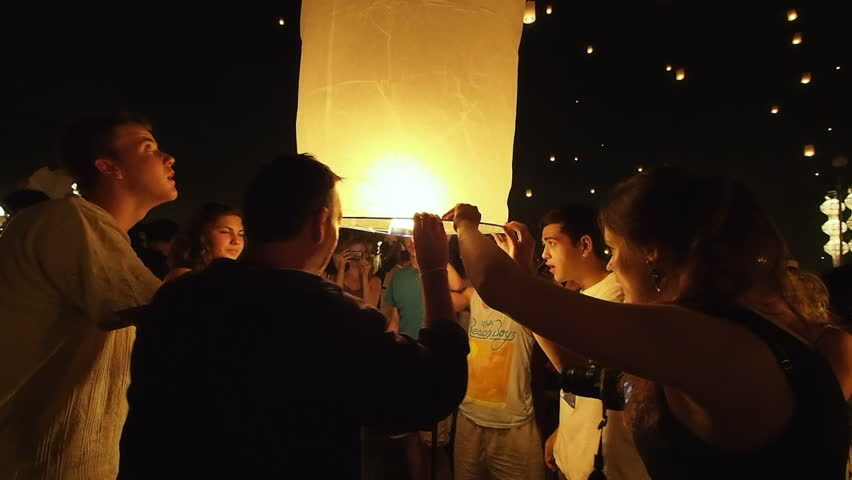 Chiang Mai, Thailand - November 16: Tourists releasing floating lantern during Loy Krathong / Yi Peng festival in Chiang Mai, Thailand.