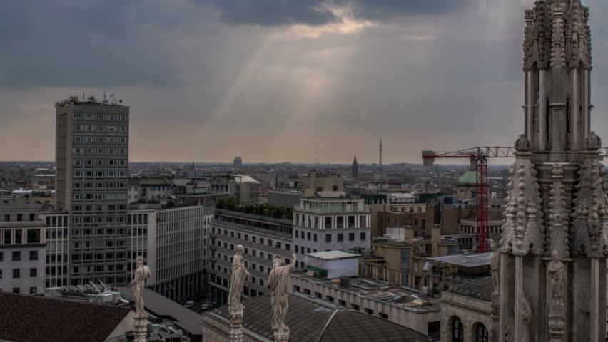 Italy, Milan skyline with sun rays time lapse