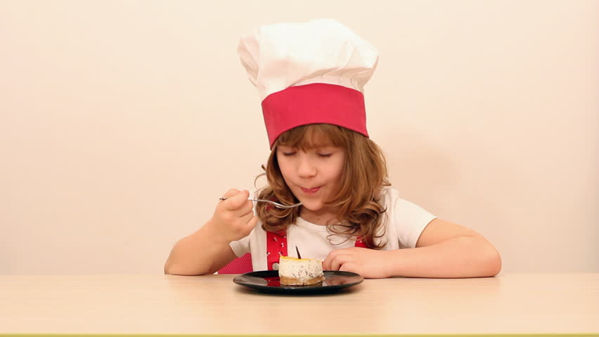 hungry little girl cook eat cake