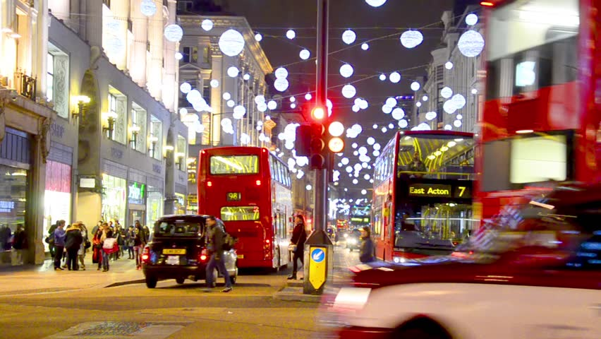 London - DEC 2013: Christmas lights and London buses at the station on busy Oxford Street London, England, United Kingdom in December, 2013. Oxford circus at traffic rush.
