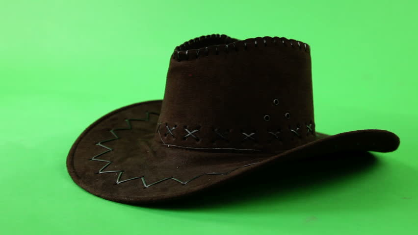 cowboy hat on a turn table isolated green screen, seamless loop