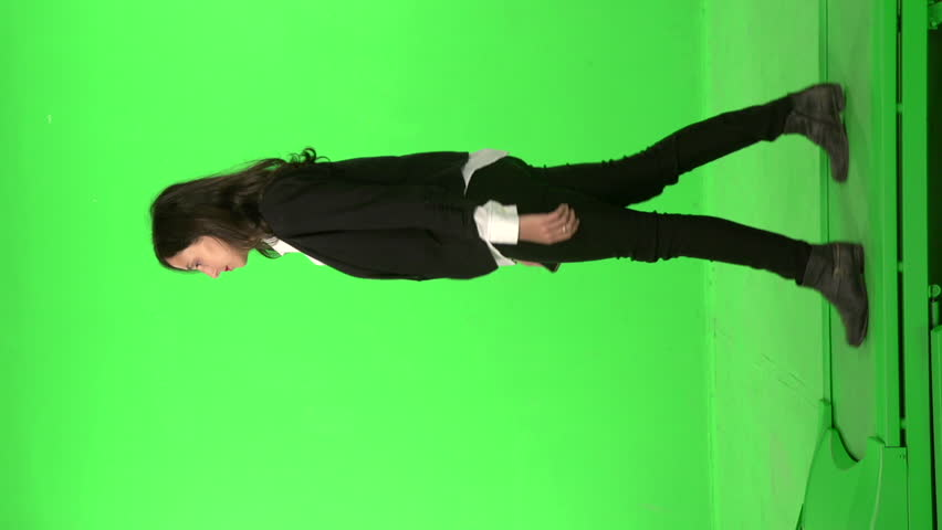 Business Woman walk, and talk on the phone, on a green screen backround #5226191