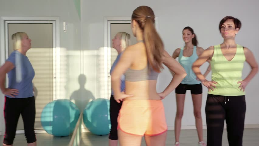 People training in fitness club, gym and sport activity. Group of women with personal trainer exercising in pilates lesson. 23of27