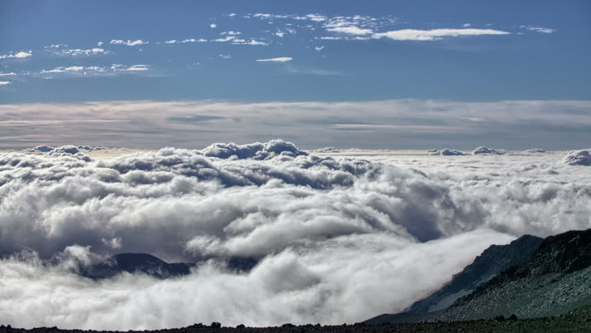 Stock video of 4k clouds drifting through mountain range 5238431 stock video of 4k clouds drifting through mountain range 5238431 shutterstock publicscrutiny Gallery