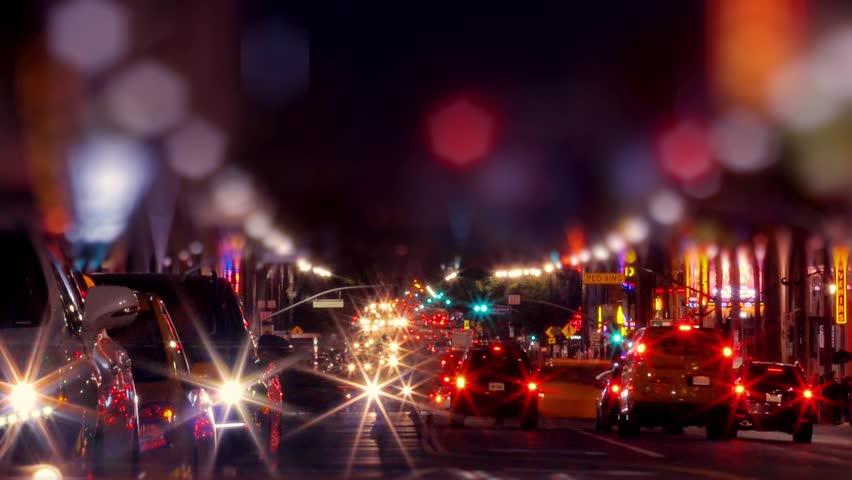 Night traffic on Hollywood Boulevard in Los Angeles. Timelapse.