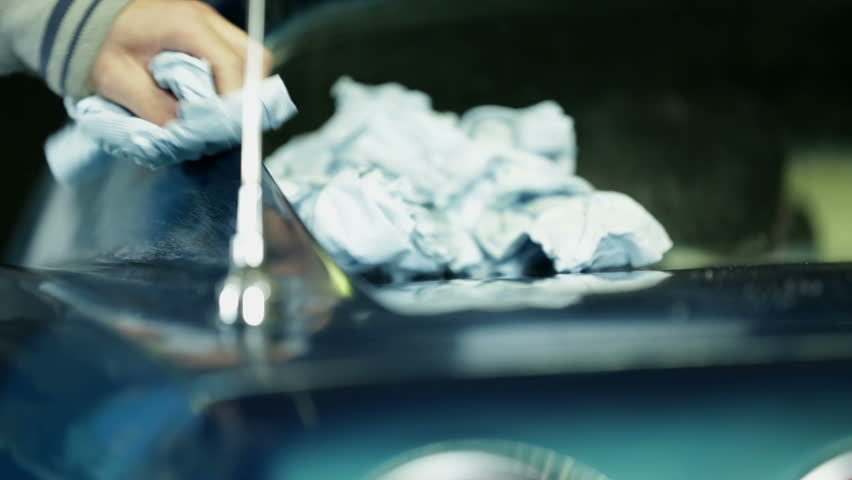 Polishing the blue car with white cloth | Shutterstock HD Video #5259773