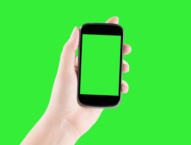 Holding Smartphone, Closeup of female hands using a smart phone. chroma key, green screen. 4K