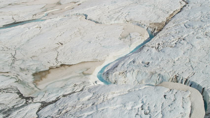 Aerial View Ice Blue Water Cutting Across Frozen Glacier USA - Usa northern hemisphere