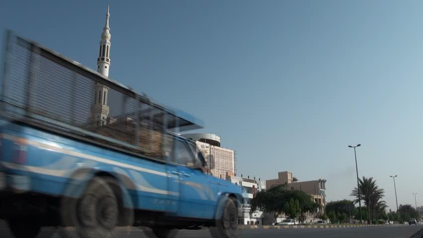 BANDAR ABBAS, IRAN - 31 OCTOBER 2013: Traffic drives past a minority Sunni mosque in Bandar Abbas, Iran