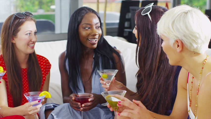 Happy attractive group of female friends chatting over cocktails and having a good time. In slow motion. | Shutterstock HD Video #5268521