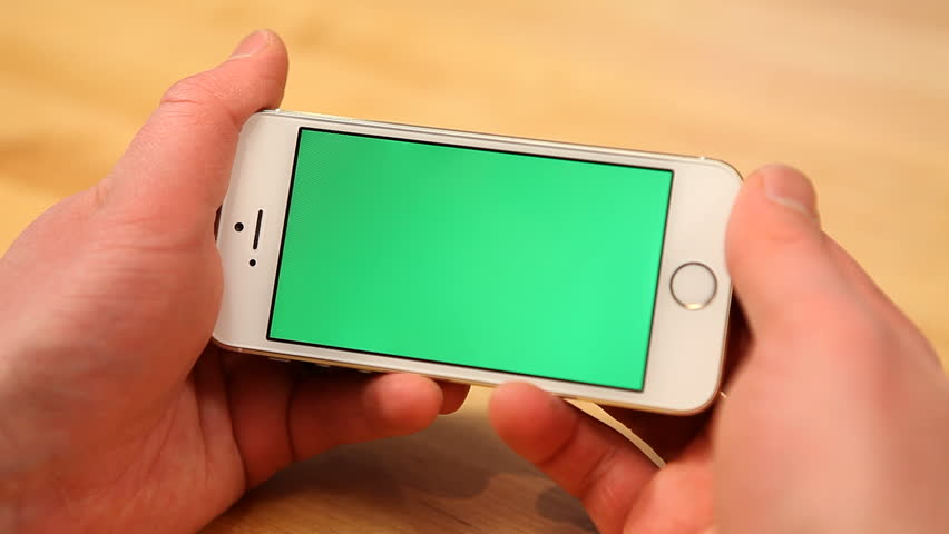 Using smart phone on wood table w/various hand gestures, horizontal, close up - green screen | Shutterstock HD Video #5292701