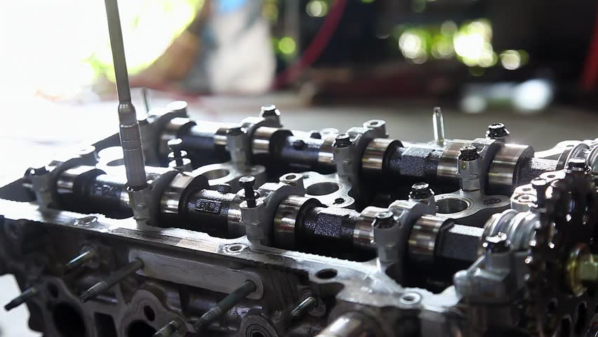 Mechanic Fixing Camshaft Of Car Engine With Socket Wrench Stock ...