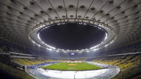 KYIV, UKRAINE - DECEMBER 12: Panoramic view of Olympic stadium during UEFA Europa League game between FC Dynamo Kyiv and Rapid Wien on December 12, 2013 in Kyiv, Ukraine (Time Lapse)