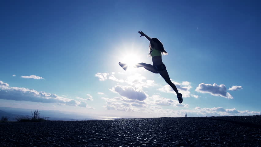 Woman Jumping At Sunset silhouette