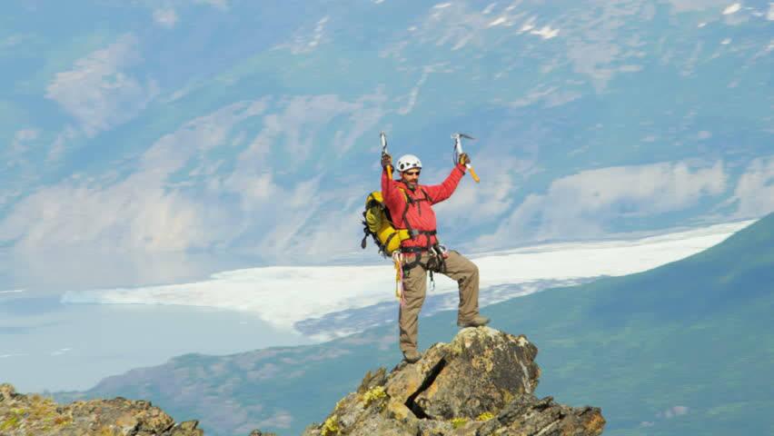 Aerial Top of the World view of successful Peak climber Troublesome Glacier, Chugach Mountains of southern Alaska, USA shot on RED EPIC, 4K, UHD, Ultra HD resolution   Shutterstock HD Video #5317919