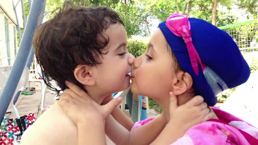 Young Love - A Little Boy Gives A Kiss To A Little Girl -2256