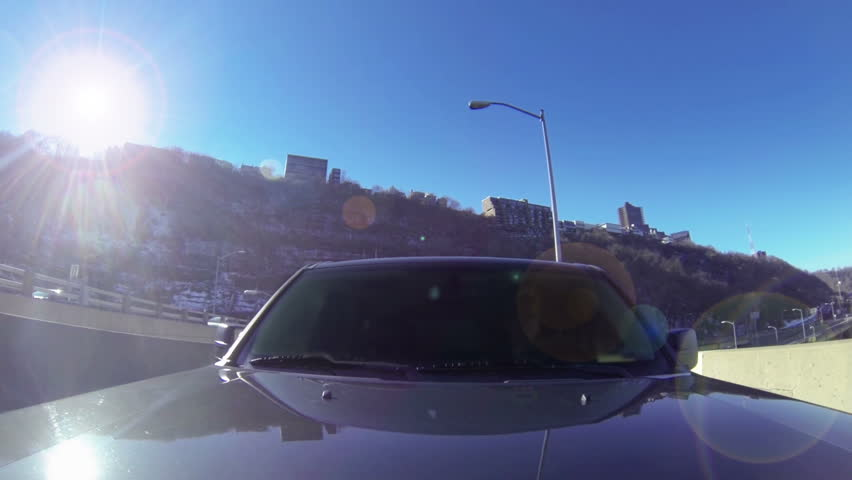 A reverse perspective of driving over the Fort Pitt Bridge in downtown