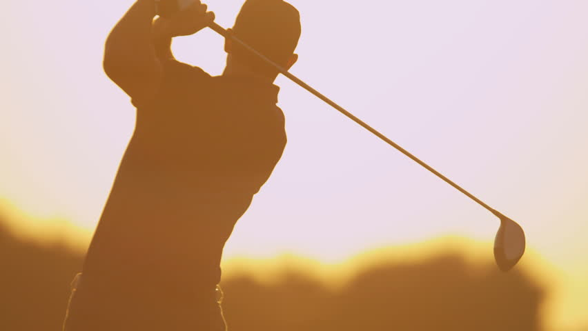 Male Caucasian golfer in sunset silhouette enjoying vacation luxury resort using driver to tee off golf course fairway slow motion shot on RED EPIC, 4K, UHD, Ultra HD resolution | Shutterstock HD Video #5336960