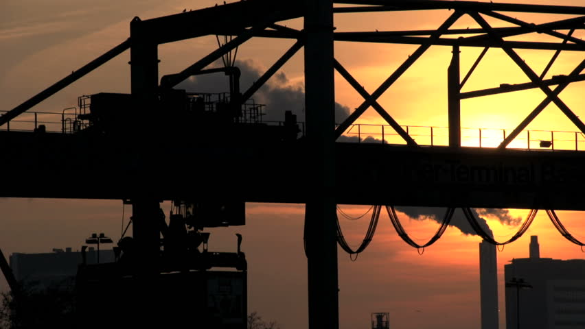 Container. moving container. crane. industrial industry business. logistics trade transportation. smog pollution smoke. sunset dusk. silhouette. 1920x1080   | Shutterstock HD Video #5356331