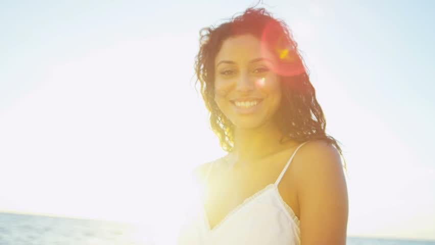 Portrait beautiful Hispanic girl dressed in white smiling to camera sunrise shot on RED EPIC, 4K, UHD, Ultra HD resolution