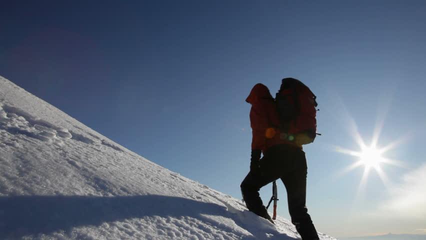 Mountaineer reaches the summit of a mountain peak - HD1080p Canon 5DMkII
