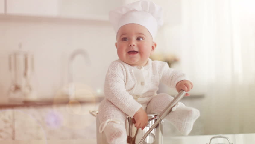 Little cook sitting in pot with ladle in hand. Lens flare and sunlight | Shutterstock HD Video #5379041