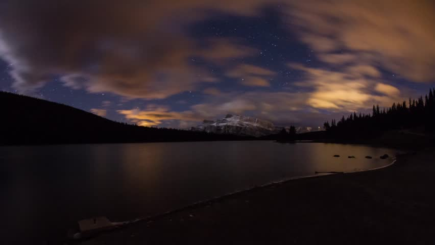 Time Lapse shot of Two Jack Lakes night clouds in Banff National Park with Mount Rundle