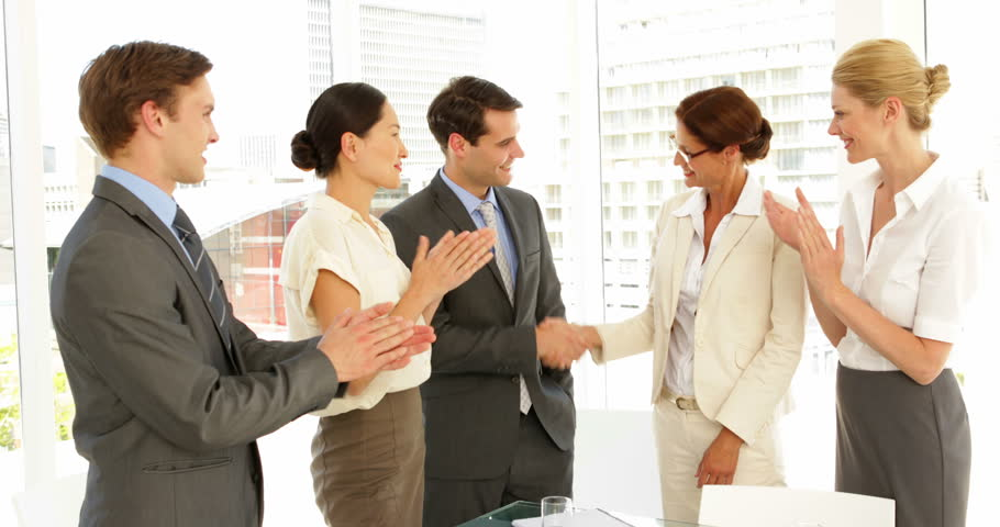 Business people shaking hands at interview while others clap at the office | Shutterstock HD Video #5382671