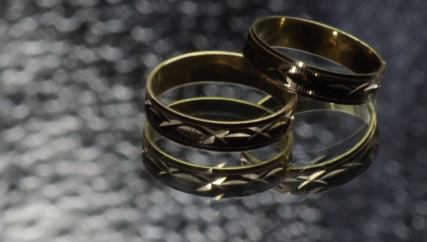 Gold Rings Model That Slip A Glass Surface Stock Footage Video